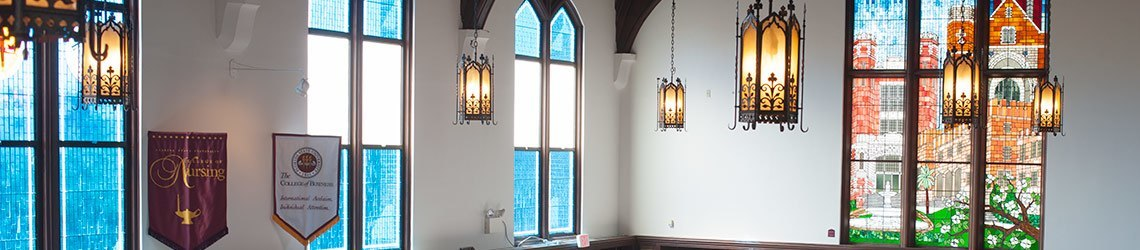 Photo of the stained glass windows inside of Dodd Hall