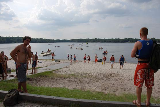 Photo of students relaxing on the beach area of the FSU Reservation during Summer