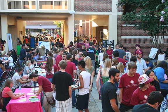 Photo of students engaging with organization's booths during a club fair in the Ogelsby Union courtyard