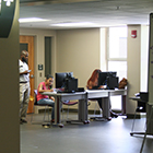 Photo of students at work stations in an office on FSU's campus
