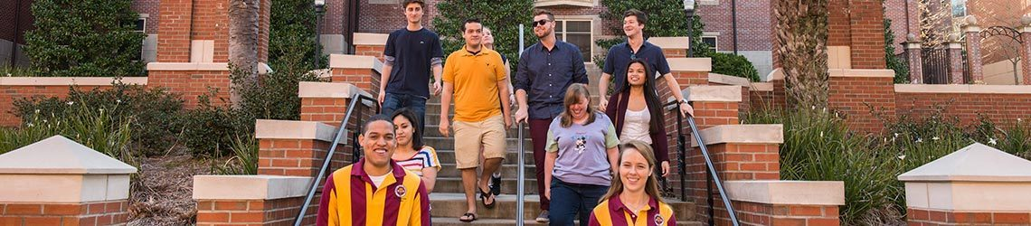 Photo of Orientation leaders touring with students through campus