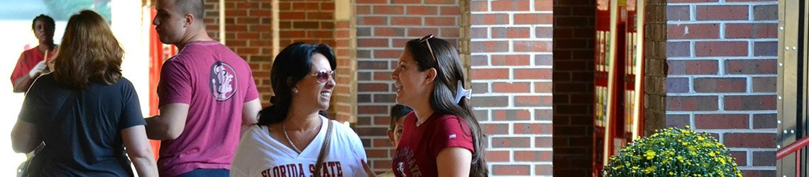 Photo of a family on the campus of Florida State University during Parents' Weekend