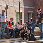 Photo of students in front of a residency hall on campus